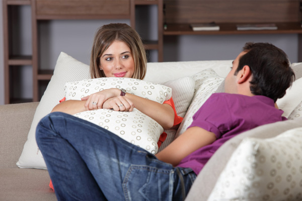 Couple talking on the couch