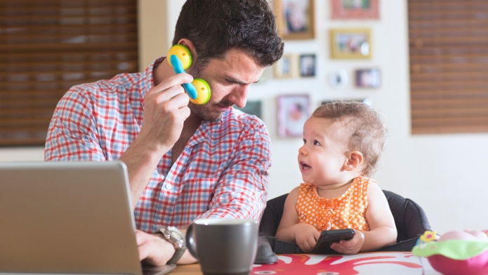 Man and baby sitting at kitchen
