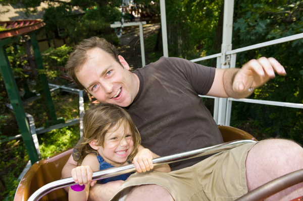 dad and daughter on rollercoaster