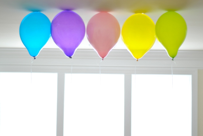 Colorful balloons floating on ceiling.