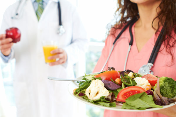 Doctor and nurse with healthy foods | Sheknows.ca