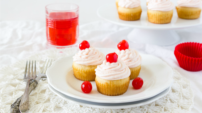 Shirley Temple cupcakes with a cherry