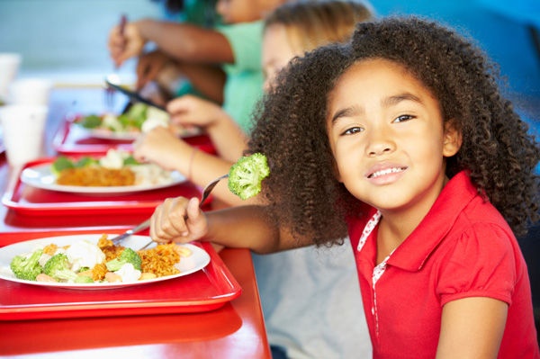 Little girl eating lunch at school