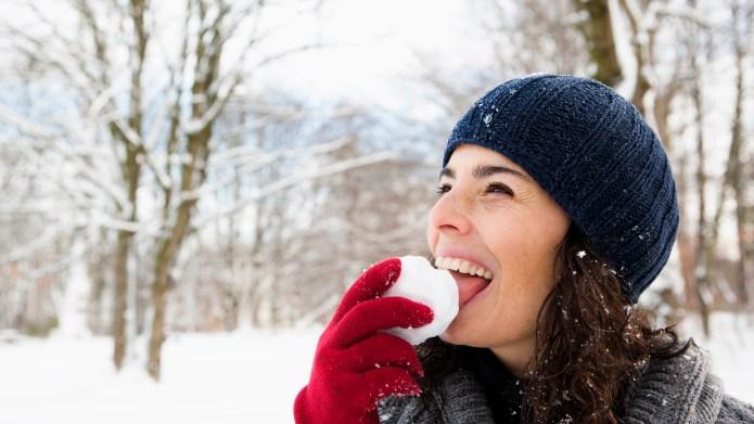 Woman eating snowball