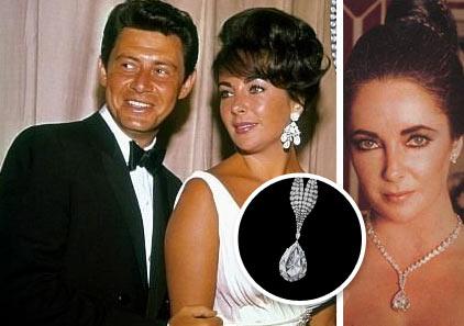 Elizabeth Taylor wearing diamond earings next to Eddie Fisher