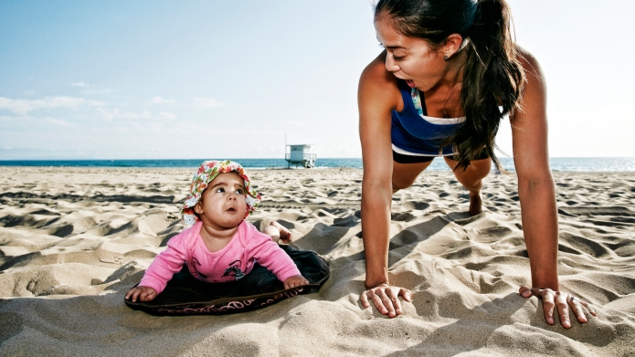 Mother and daughter doing push-ups at