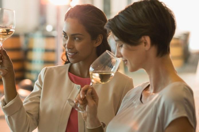 Women wine tasting at winery