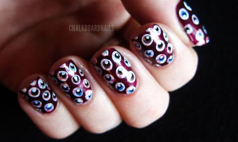 Graphic eyeball nail design