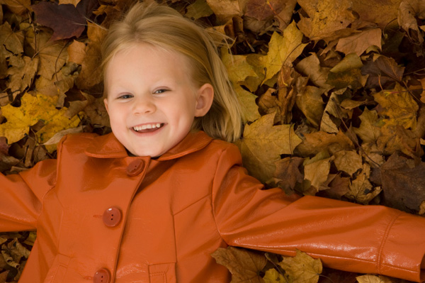 Little Girl in Leaves