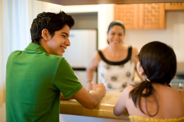 Family in kitchen with bar