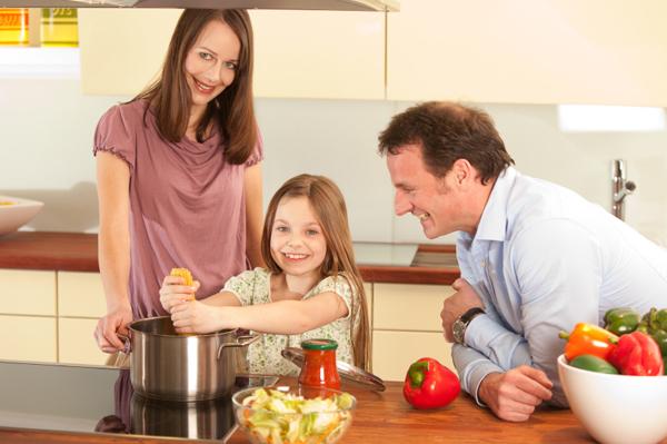 Family making pasta dinner