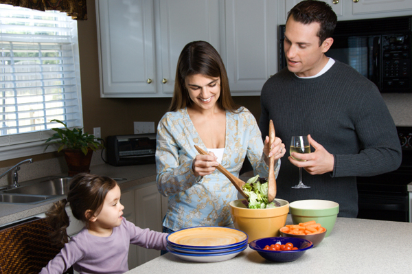 Family making salad at home