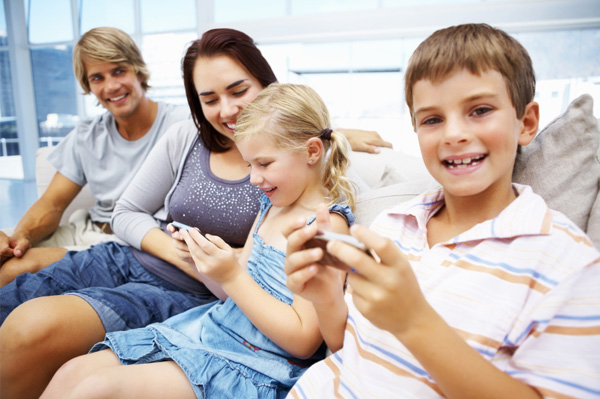 family on electronics at home