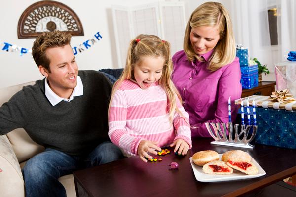 Family Playing Dreidel