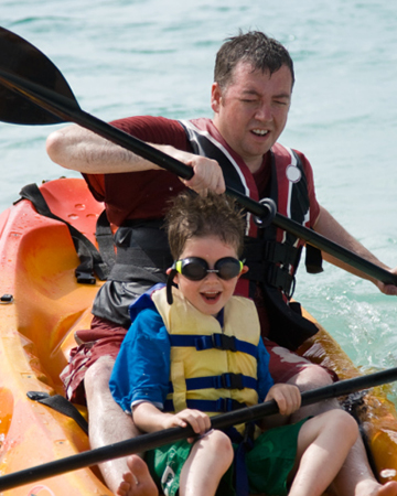 Father and son kayaking | Sheknows.com