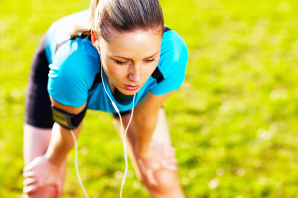 Fatigued woman running