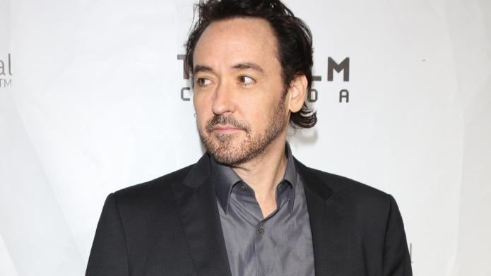 John Cusack compares Hollywood to a