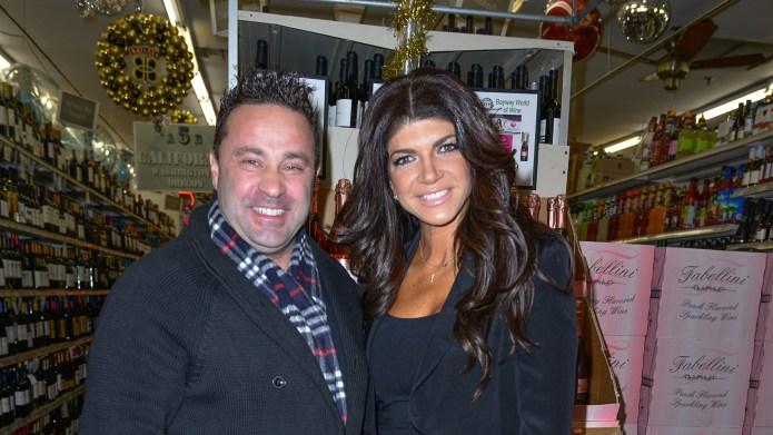 Teresa Guidice and Joe Giudice sign