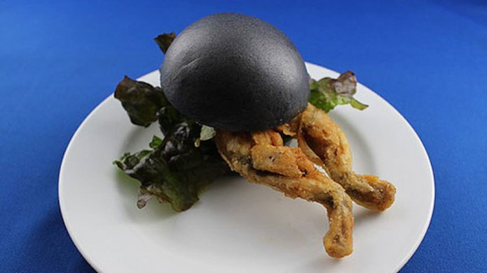 This black-bunned deep-fried frog burger is