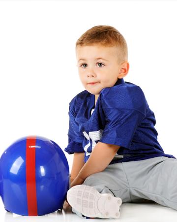 Little boy with football helmet | Sheknows.com