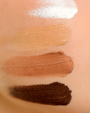Foundation swatches on face