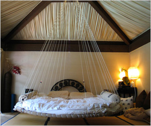 The Floating Bed Looks Like A Flat Bottomed Papasan Chair That Hangs From Ceiling In Elegant Or Casual Bedrooms On Tripod Lushly Landscaped