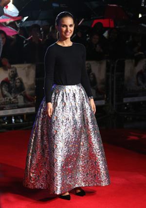 Natalie Portman wearing black cashmere top and sparkly ballroom skirt