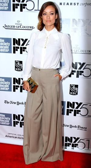 Olivia Wilde in grey parachute pants