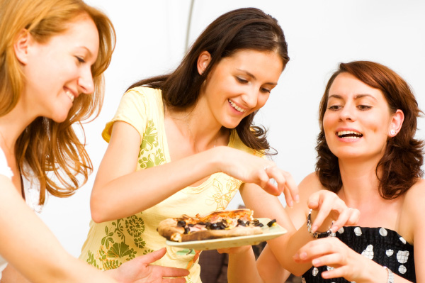 Friends eating at party