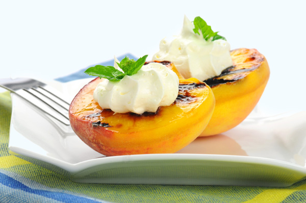 Grilled peaches with crème fraiche and basil