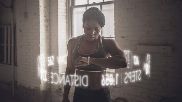 Virtual words circling Black athlete checking