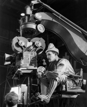 """Gene Kelly in costume behind the camera directing the """"Circus"""" segment of Invitation to the Dance"""