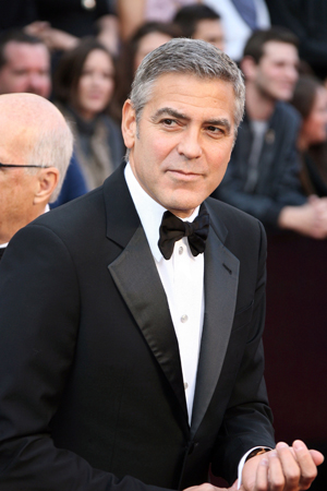 George Clooney doesn't care if you think he's gay!
