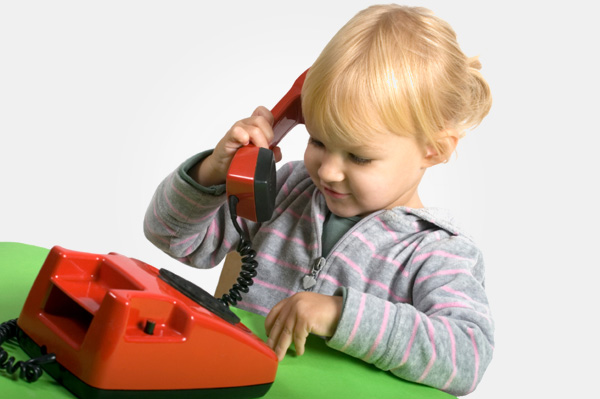 girl with toy telephone