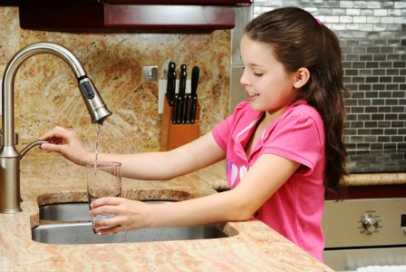 Girl drinking tap water