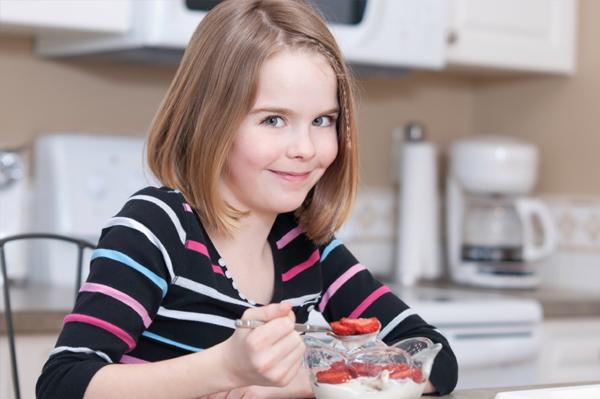 Girl eating breakfast