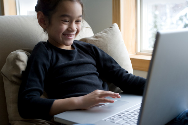 Girl playing computer game