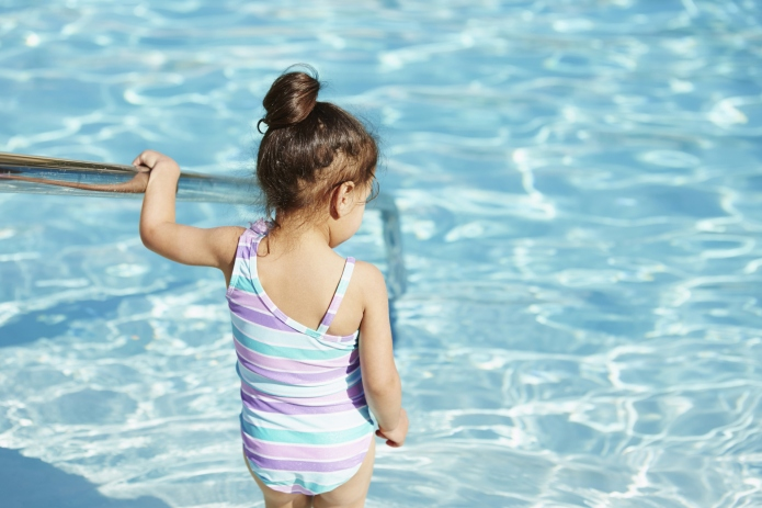 Girl climbing into pool