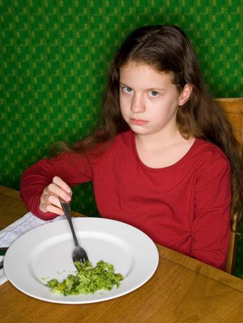 Girl Relunctantly Eating Broccoli