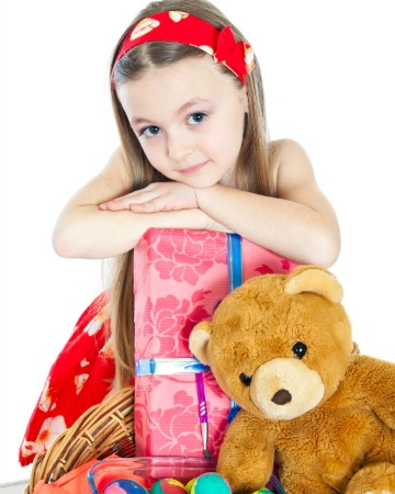 Girl with Easter basket and toys