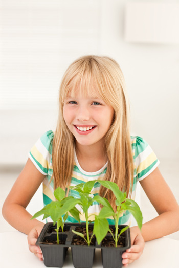 Girl with plants indoors
