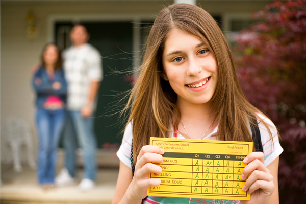 Girl with Report Card