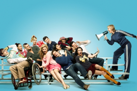 Jane Lynch meances the cast of Glee