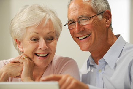 Grandparents looking at photos online