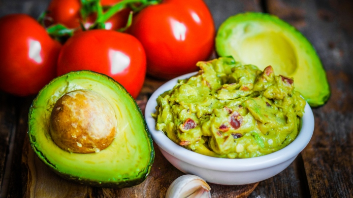 Guacamaole with bread and avocado on
