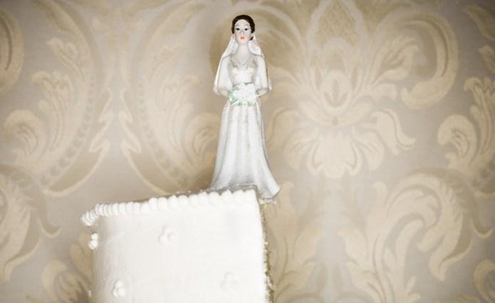 Wedding cake visual metaphor with figurine