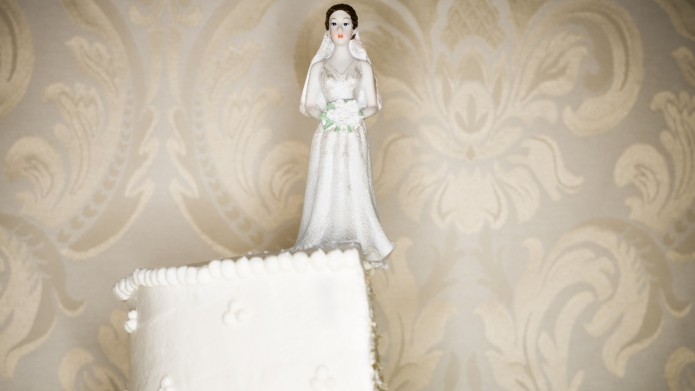 Wedding cake visual metaphor with figurine