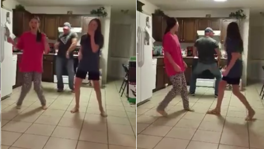 Sneaky dad steals the show dancing