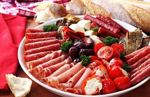 Platter of antipasto, with crusty bread.