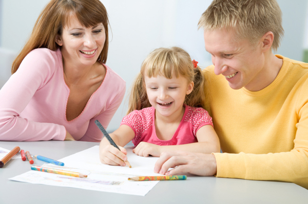 Happy family writing letter